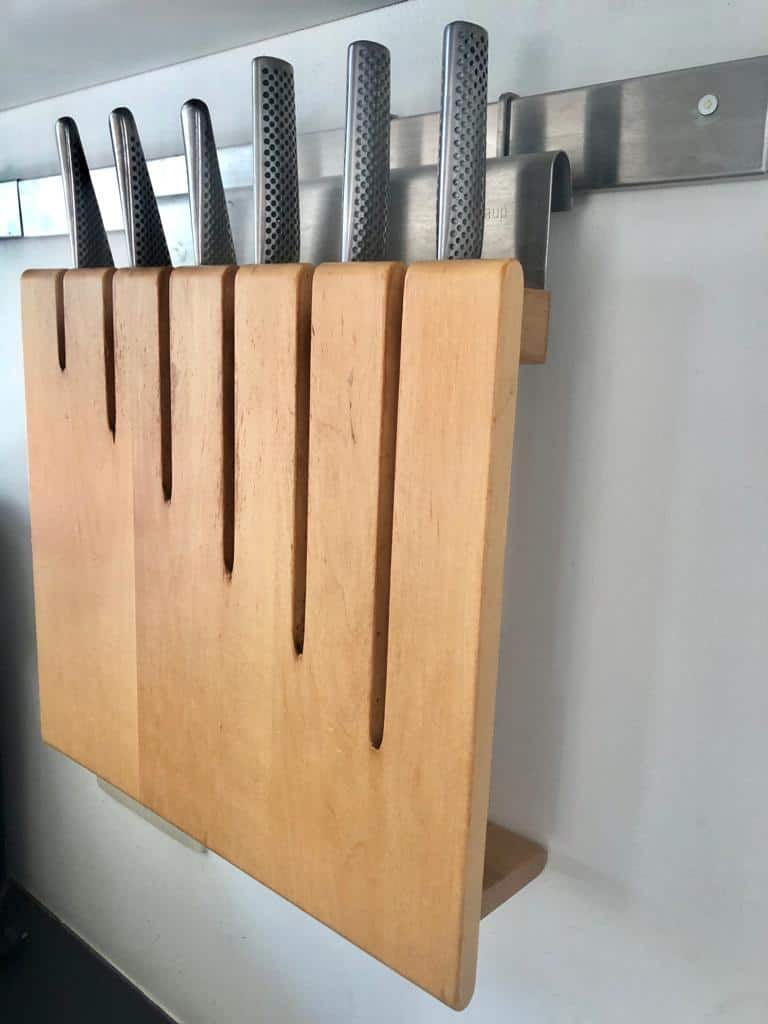 Knives rack hanging on the wall. Alternative are the magnetic knife rack that mounts on a wall.