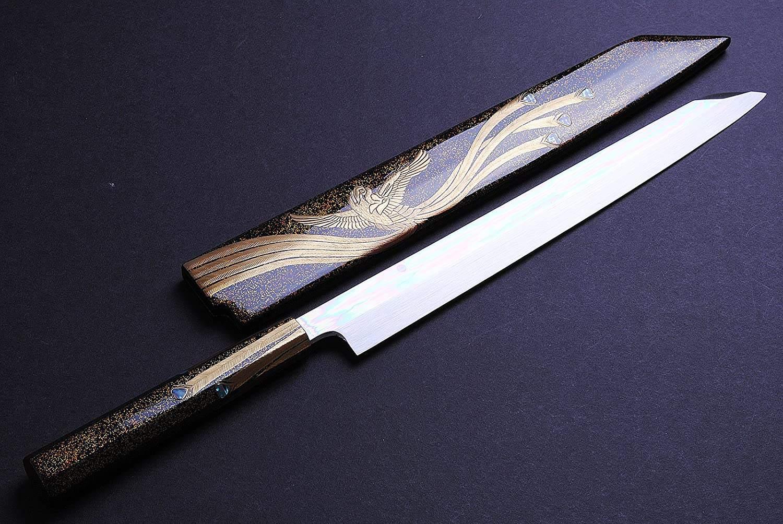 Yanagiba knife cutting fish for Sushi and Sashimi